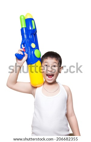 A boy wearing a white vest, His holding a water gun on shoulder and happy playing (for songkran day). isolate on white background - stock photo