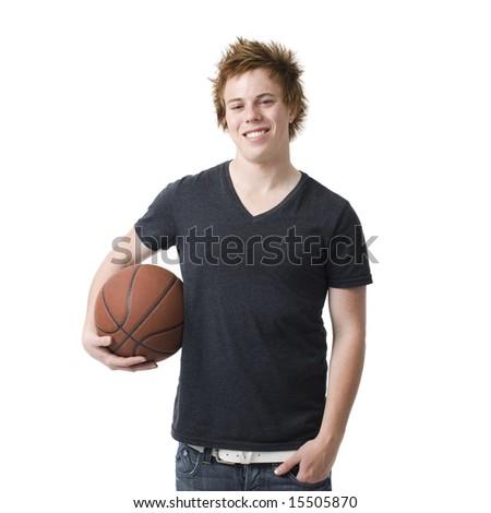 A boy with a basketball smiles - stock photo
