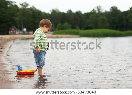 A boy with  a boat - stock photo