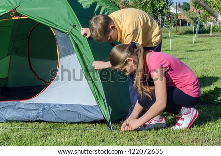 a boy with a girl pitch a tent & Pitching Tent Stock Images Royalty-Free Images u0026 Vectors ...