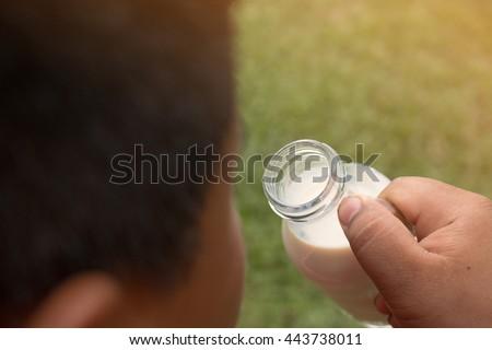 A boy with glass of milk, Drinking milk. - stock photo