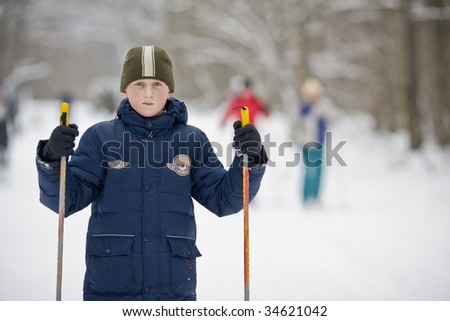 a boy with skiis in the park - stock photo