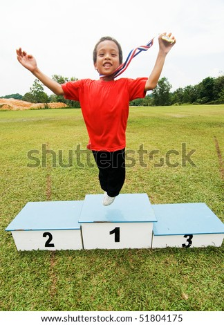 a boy with winning medal - stock photo