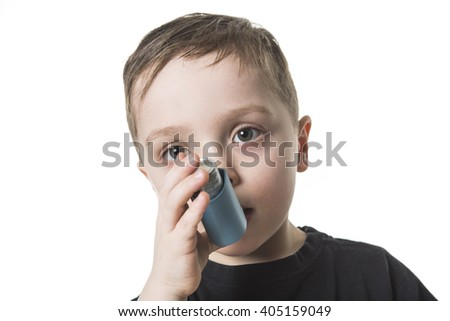 A Boy 4 years old inhales himself on a white background - stock photo