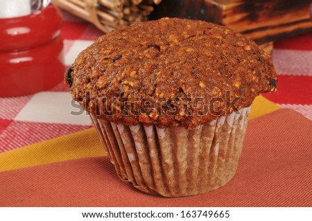 A bran muffin on a napkin - stock photo