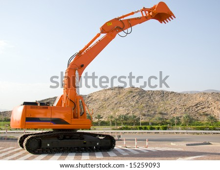 A brand new earthmover parked - stock photo