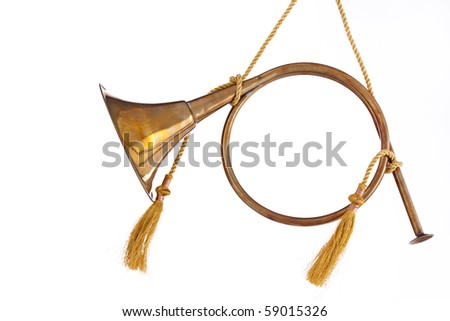 A brass gold color Christmas ornament French horn isolated on a white background in the horizontal format. - stock photo