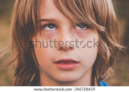 a brat little boy - thinking - stock photo