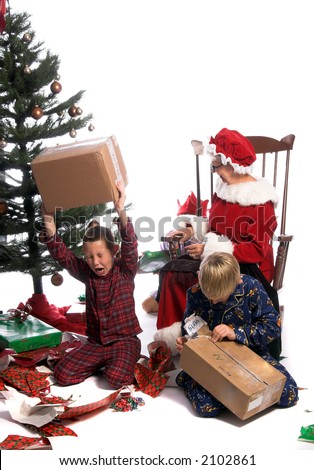A bratty child having a tantrum under the Christmas tree while his brother and Mrs. Santa look on