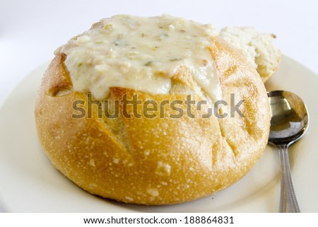 A bread bowl filled with clam chowder. - stock photo