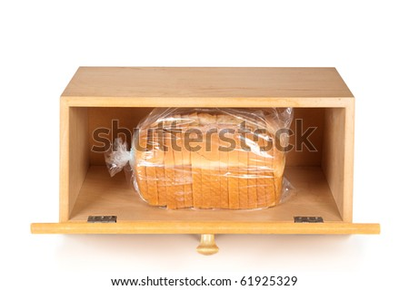 A breadbox with a fresh loaf of bread on a white background. - stock photo