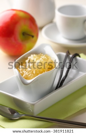 A breakfast table with pineapple jam, apple and vanilla - stock photo