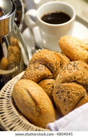 A breakfast tray with fresh bread and the morning coffee. - stock photo