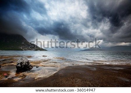 A brewing storm on the ocean in northern Norway - stock photo