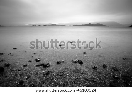 a brewing storm sky, seem sad, black and white - stock photo