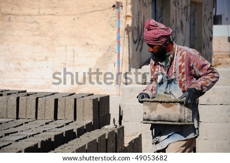A brick layer worker building a brick