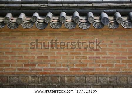 A brick wall of a Korean historical palace - stock photo