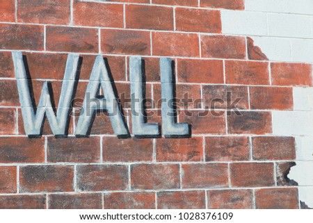 A brick wall painted to resemble bricks with the word Wall painted on it , abstract, background, art,