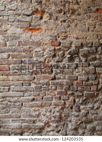 A brick wall with different textured bricks - stock photo