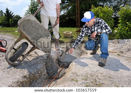 a bricklayer on a building site - stock photo