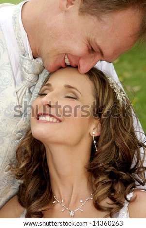 A bride and groom close together in love - stock photo