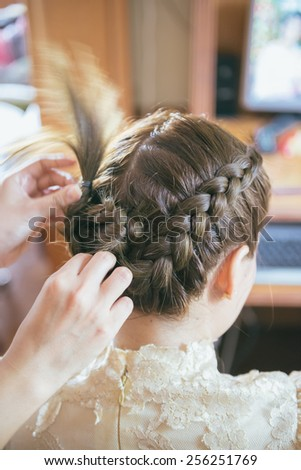 A bride at hairdressing salon before wedding