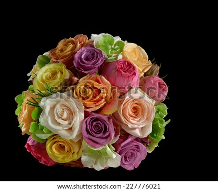 a bride bouquet with multicolored rose flowers in black back - stock photo