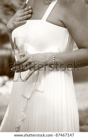 A bride enjoying the wedding reception - stock photo