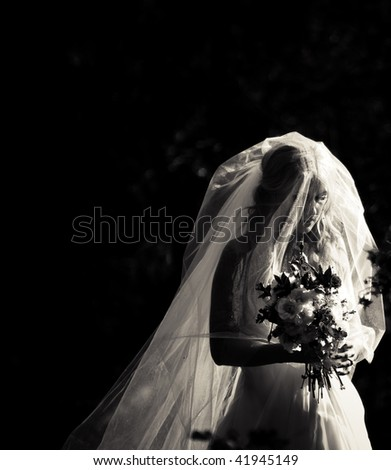 A bride getting ready to walk down the aisle. - stock photo