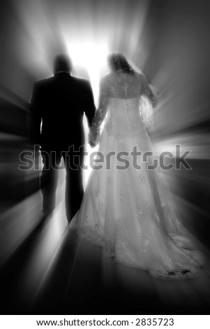 A bride & groom walk toward a new life together #1 (black & white, zoom special effect). - stock photo