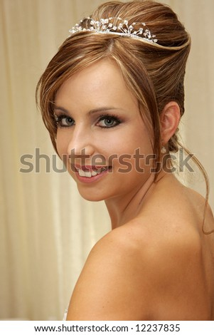 A bride looking over her shoulder - stock photo