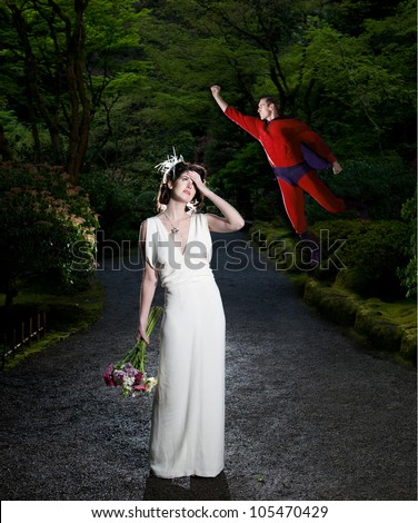 A bride swoons in distress while a superhero flies in to the rescue. - stock photo