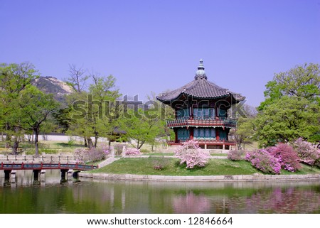 A bridge leads to an old pavillion by the water at Kyoungbok Palace in Seoul, Korea.