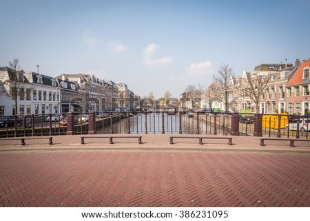 A bridge over a canal on a sunny day in Haarlem, Netherlands