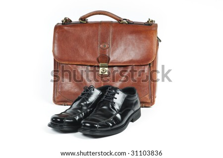 A briefcase and a pair of  shoes symbolizing a salaried employee. - stock photo