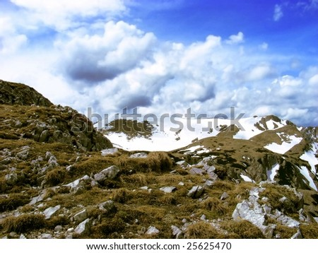 a bright and dramatic picture of the rocks at the beginning of the spring - stock photo