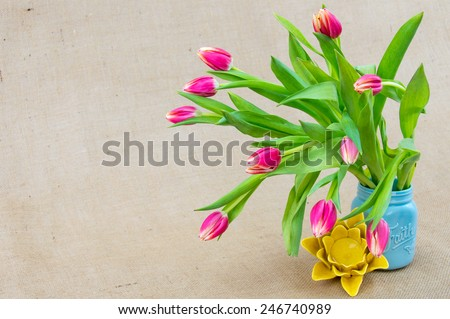a bright arrangement with pink, blue and yellow - stock photo