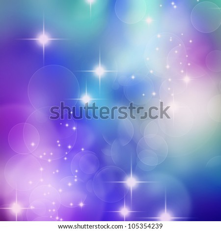 A bright  background with blue, green, violet bokeh effects - stock photo