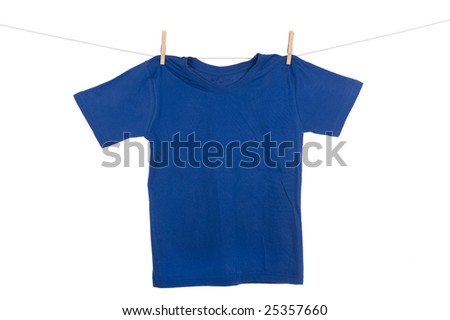 A bright colored Tee Shirt hanging on a clothesline. - stock photo