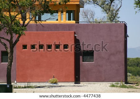 A bright, colorful house built in a contemporary southwest style. - stock photo