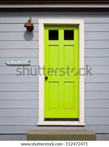 A bright lime green door with white wood trim in a light gray wood sided & Green Door Front Stock Images Royalty-Free Images \u0026 Vectors ...