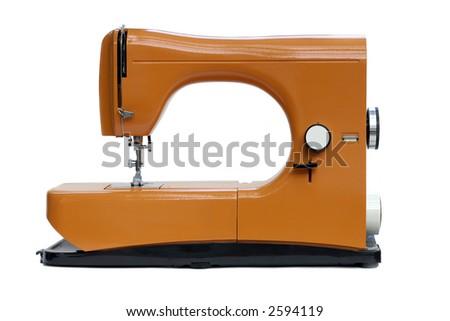 A bright orange italian eighties sewing machine isolated on white - stock photo
