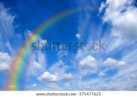 A bright rainbow in the sky - stock photo
