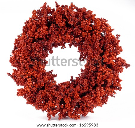 A bright red Christmas ornament on a white back ground - stock photo