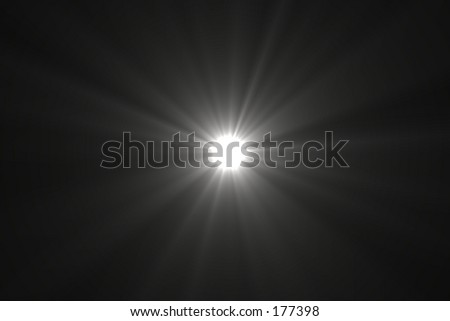 A bright white point of light with rays radiating off it, against a black backdrop. - stock photo