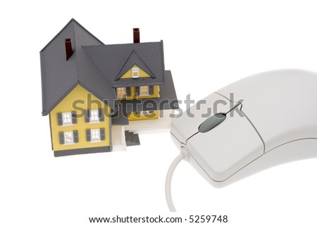 A bright yellow house with a computer mouse - stock photo