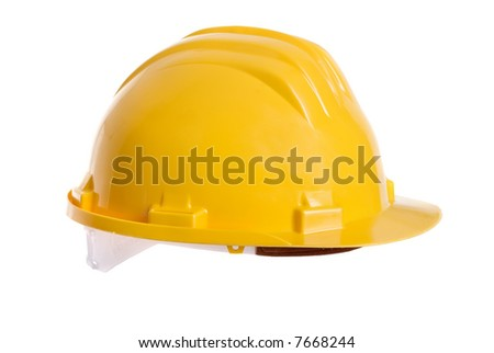 A bright yellow safety hardhat from a construction site. - stock photo