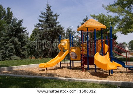A brightly colored playground waits ready for child play. - stock photo