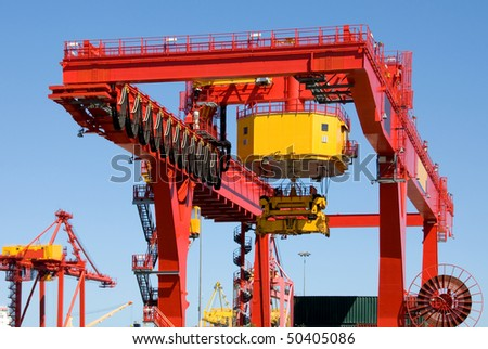 A brightly coloured container loader at an Australian port