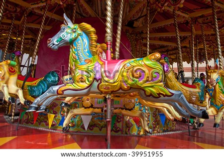 A brightly coloured merry go round horse called Sherman - stock photo